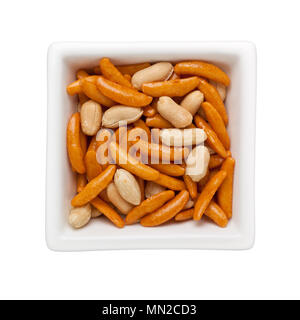 Japanese snack - Rice crackers and peanuts in a square bowl isolated on white background - Stock Image