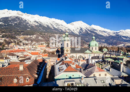 Austria, Tyrol, Innsbruck, Panoramic views of the city with snow-capped Alps in background - Stock Image