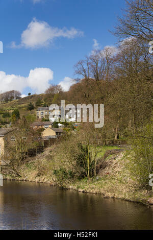 Houses old and modern on a hillside overlooking the Rochdale canal in the village of Walsden near the Lancashire/Yorkshire - Stock Image