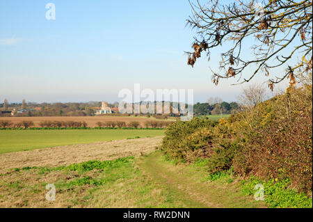 A public footpath and circular walk with views to Morston from the Downs in North Norfolk at Blakeney, Norfolk, England, United Kingdom, Europe. - Stock Image