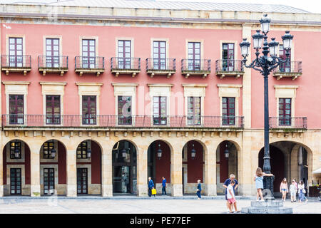 Gijon, Spain - 6th July 2018: People in the Plaza Mayor. This is the main square in the city. - Stock Image