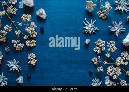 White Sage and Native Flowers with Quartz and Blue Agate, arranged with Space for Copy - Stock Image