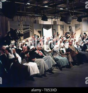 1960s, group of Saudi men in traditional arab dress in a television studio, Saudi Arabia. - Stock Image