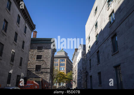 MONTREAL, CANADA - NOVEMBER 4, 2018: Royal Bank skyscraper taken from a nearby street in the district of the Old Montreal, or Vieux Montreal, in the c - Stock Image
