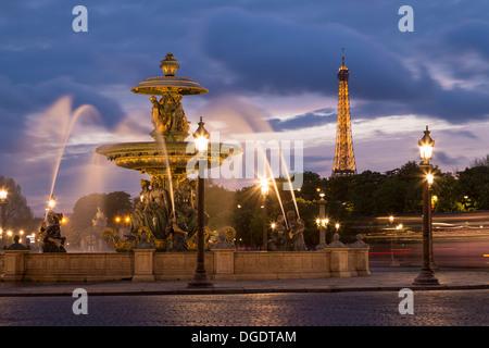 Place de la Concorde fountains and Eiffel Tower at sunset Paris France - Stock Image