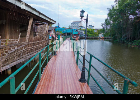 Riverside boardwalk, Khlong Trat riverside, Trat, Thailand - Stock Image