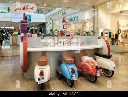 Retro scooter themed Joe Delucci's Gelato kiosk in Westfield Stratford, East London - Stock Image