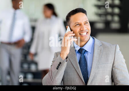 modern mid age business executive talking on cell phone - Stock Image