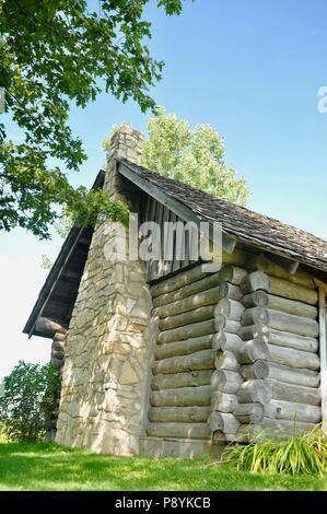 Log cabin replica at the site of Laura Ingalls Wilder's birthplace, setting for book 'Little House in the Big Woods', Pepin, Wisconsin, USA - Stock Image