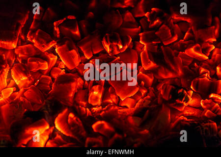 Red hot glowing embers of a log fire. - Stock Image