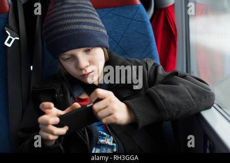 Boy with cell phone - Stock Image