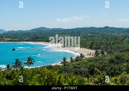 All-terrain vehicles riding along a beach at Amber Cove in the Caribbean; Dominican Republic - Stock Image