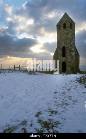 St Catherine's 14th century lighthouse in snow, St Catherine's Down, Chale, Isle of Wight, England - Stock Image