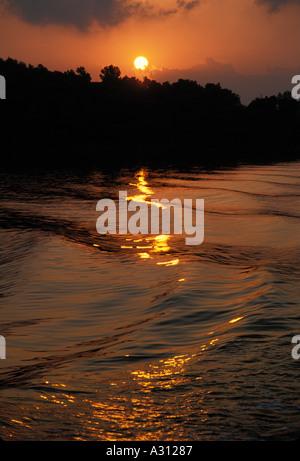 Sunrise over Poros in Greece - Stock Image