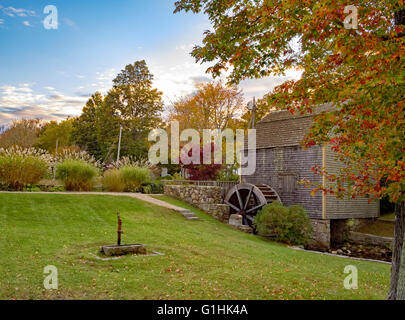 Dexter Grist Mill, Sandwich, Cape Cod Massachusetts undershot wooden water wheel and millrace in autumn, fall colors - Stock Image