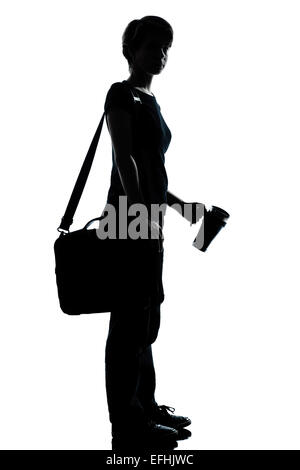 one caucasian young teenager silhouette boy or girl school student  full length in studio cut out isolated on white - Stock Image