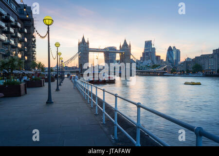 Tower Bridge and City of London skyline from Butler's Wharf at sunset, London, England, United Kingdom, Europe - Stock Image