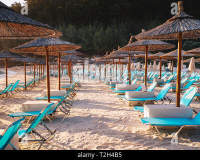 Free chairs and umbrellas on the beach in Thasos, Greece - Stock Image