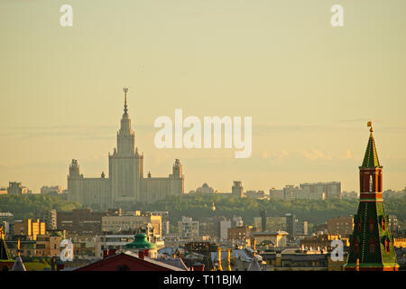 MOSCOW, AUGUST 8, 2018: View of Moscow city, Corner Arsenal tower of the Kremlin, tall building of Moscow State University on Sparrow Hills in the bac - Stock Image