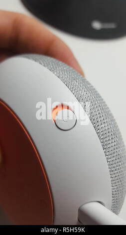 microphone button of a Google Home Mini device - Stock Image
