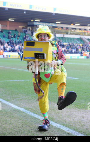 Norwich football club famous speed camera photographer taking pictures of the fans at carrow road. - Stock Image