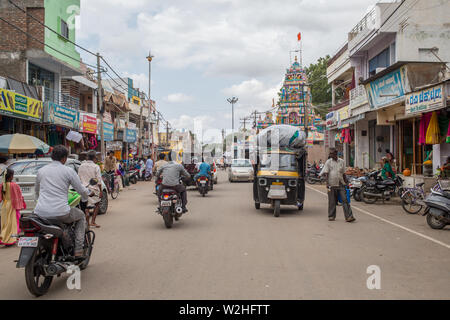 A street in a smaller town in south India on a hot summer afternoon - Stock Image