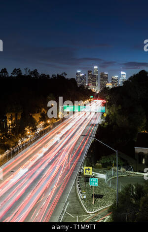 Long exposure cars driving along freeway, Los Angeles, California, USA - Stock Image