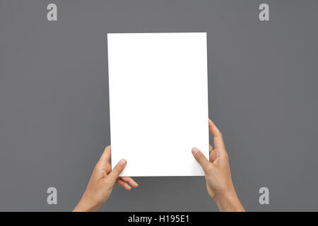 Closeup Blank White Paper Sheet Mockup Holding Female Hands Abstract Gray Background - Stock Image