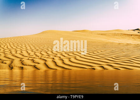 Mirage of the water in the Arabian desert. Background image digital enhancement - Stock Image