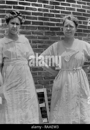 Two middle aged women stand for a portrait, ca. 1930. - Stock Image