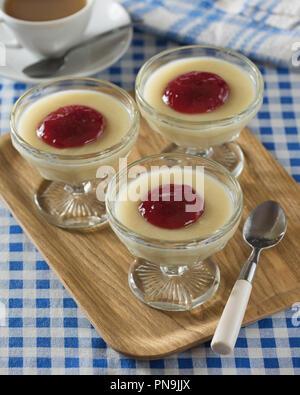 Semolina pudding with jam. Traditional dessert. Food UK - Stock Image