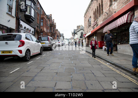 A view looking up Conwy High Street ringed by a circuit of walls from the Quay in North Wales - Stock Image
