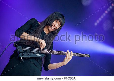 Japanese acid punk band Bo Ningen performing live : Taigen Kawabe (bass/ vocals) - Stock Image