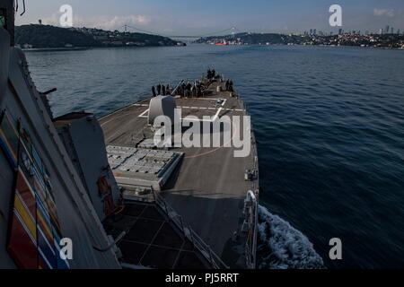 180827-N-UY653-058  BOSPHORUS STRAIT (Aug. 27, 2018) The Arleigh Burke-class guided-missile destroyer USS Carney (DDG 64) transits the Bosphorus Strait Aug. 27, 2018. Carney, forward-deployed to Rota, Spain, is on its fifth patrol in the U.S. 6th Fleet area of operations in support of regional allies and partners as well as U.S. national security interests in Europe and Africa. (U.S. Navy photo by Mass Communication Specialist 1st Class Ryan U. Kledzik/Released) - Stock Image