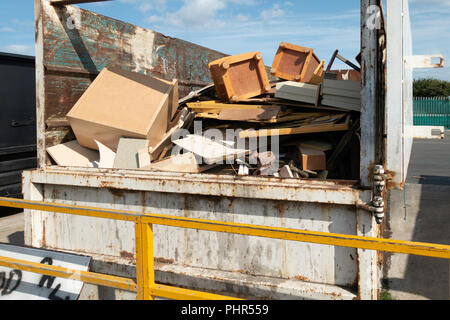 An English Local Authority Recycling centre skip for disposal of wood overfilled and difficult to use - Stock Image