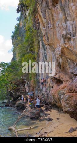 People climbing Muay Thai wall, Railay, Krabi province, Thailand - Stock Image