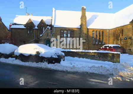 The library, Hook Norton, Oxfordshire in the sunshine following a severe snowfall - Stock Image