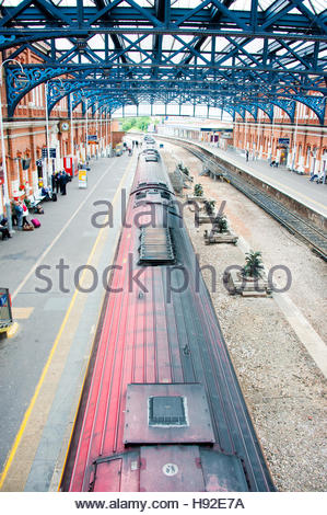 A Crosscountry train on Bournemouth Railway Station platform, destination Manchester, also showing the shed roof - Stock Image