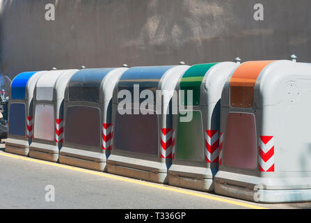 Row of bins for the separate collection of glass, paper and aluminum in the street - Stock Image