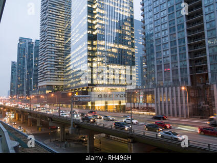 Gardiner Expressway and Condo Towers: A busy raised expressway cuts through high office and condo towers in downtown Toronto  during the morning commute - Stock Image