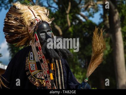 Dan tribe mask sacred dance during a ceremony, Bafing, Gboni, Ivory Coast - Stock Image