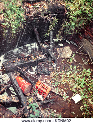 Disused Basingstoke Canal – a derelict lock chamber at Deepcut Locks  near Pirbright, Surrey, UK - 1968 - Stock Image