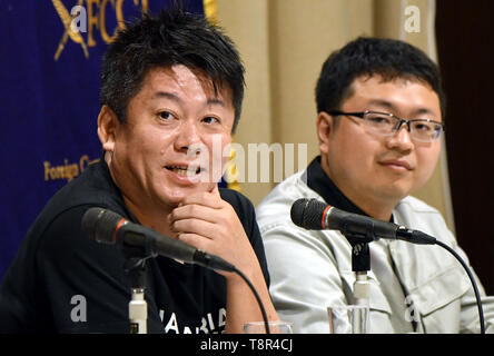 May 15, 2019, Tokyo, Japan - Controversial Japanese entrepreneur Takafumi Horie?speaks during a news conference at the foreign correspondents club in Tokyo on Wednesday, May 15, 2019. Earlier this month, a private space company Horie and a group of investors founded successfully launched an unmanned rocket into space, achieving an altitude of 113 km in four minutes before dropping in the Pacific Ocean. The Interstellar Technologies is now developing a rocket that can put small satellites into orbit, and hopes to begin commercial operations in 2023. At right is CEO Takahiro Inagawa of Interstel - Stock Image