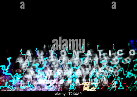 Light blurred pattern at night. The word 'automatico' can be read. - Stock Image