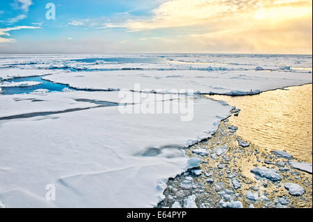 Pack ice breaking up in Svalbard in the arctic north of Norway. - Stock Image