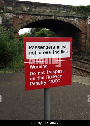 Passengers must not cross the line sign on railway platform - Stock Image
