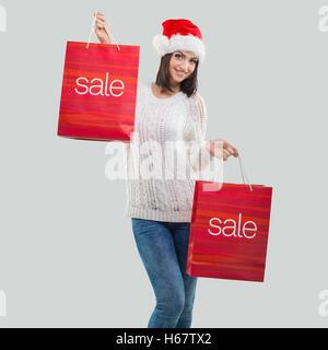 Santa Women, with sale bag - Stock Image