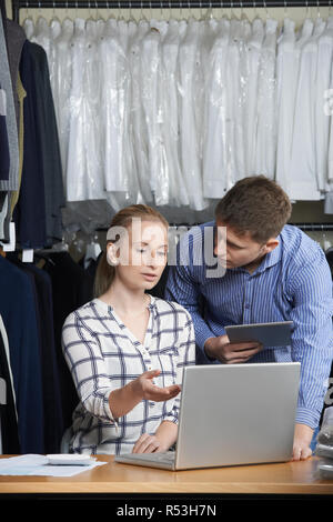 Couple Running On Line Fashion Business Working In Warehouse - Stock Image