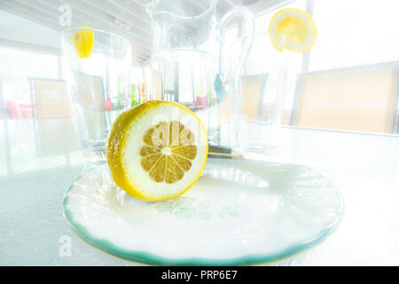 Artistic View Of Lemon On Bright White Porch - Stock Image