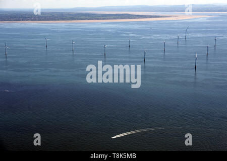 aerial view of a wind farm in the Irish Sea with the Wirral coast in the background - Stock Image
